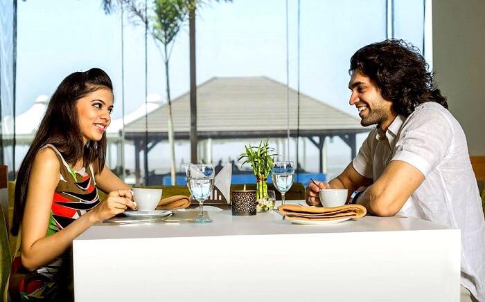 Couple having lunch at Golden Beach resort Daman