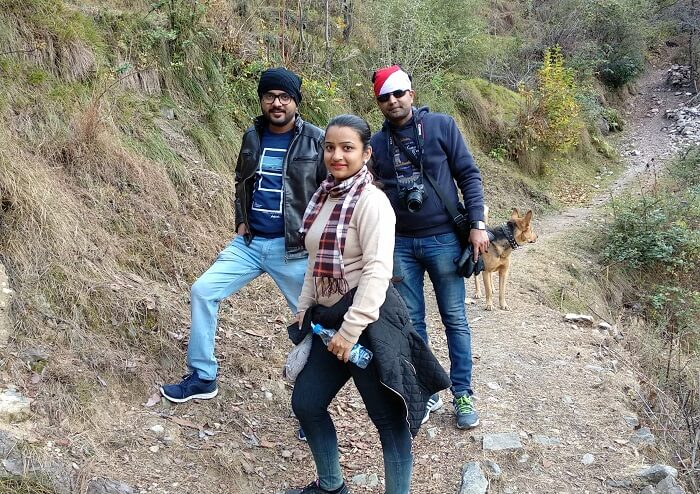 trekking to waterfall in tirthan