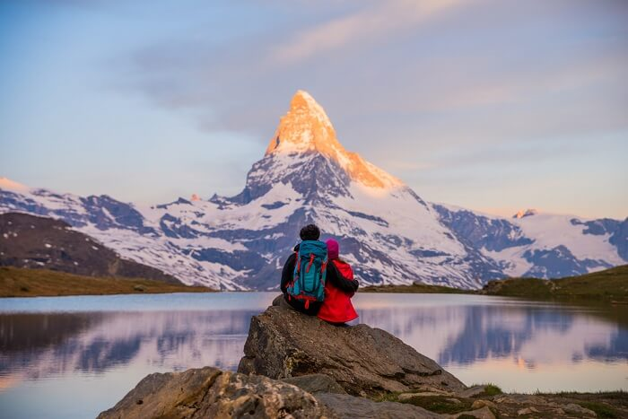 Couple In Swiss Alps, Switzerland