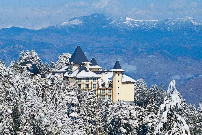 Snow covered cecil hotel in shimla