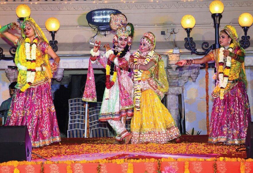 girl and boy dressed in Radha Krishna attire for holi