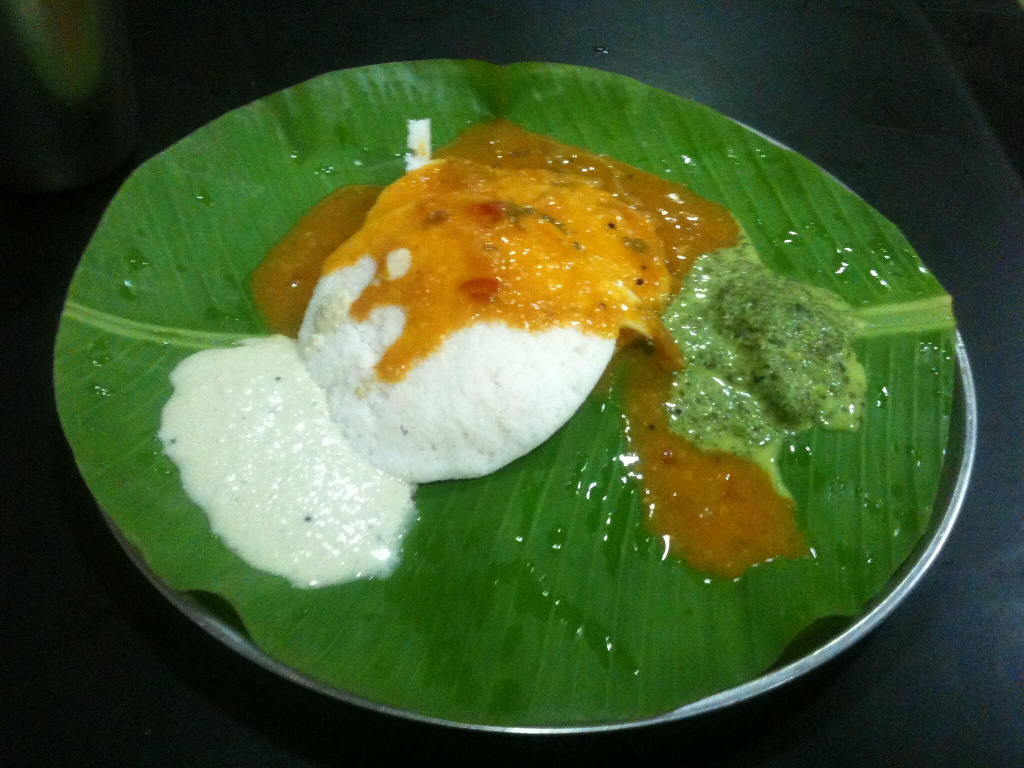 street food idli on banana leaf