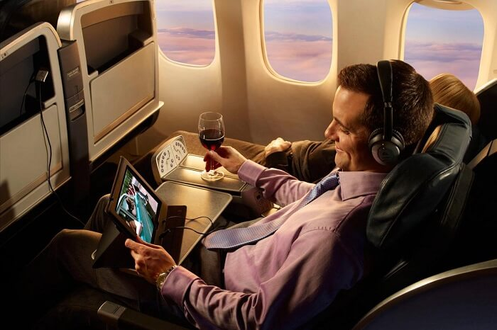 a passenger enjoying internet services to watch a video on personal device on flight