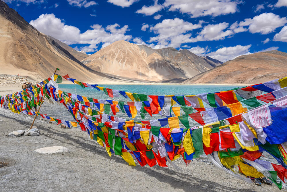 colourful prayer flags at Pangong Lake