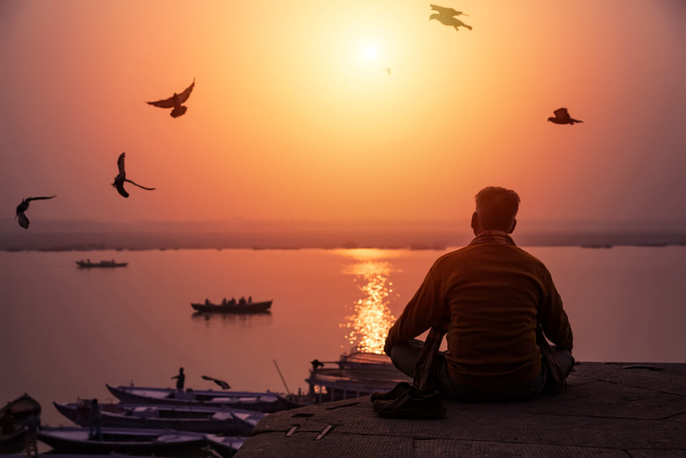 a guy sitting at Banaras ghat
