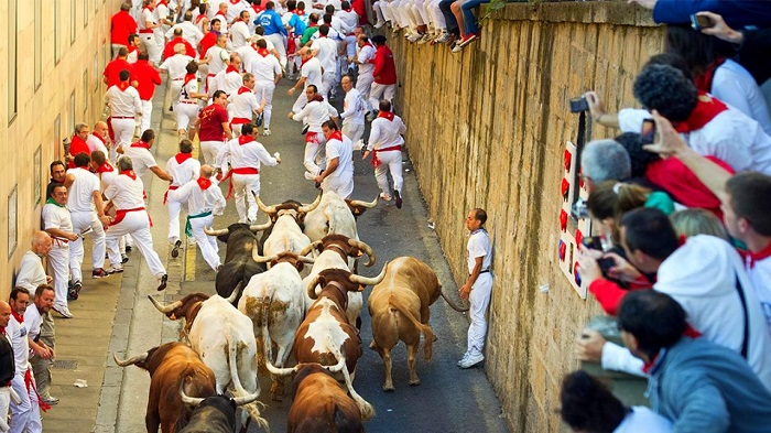 Be part of the San Fermin parade in Spain
