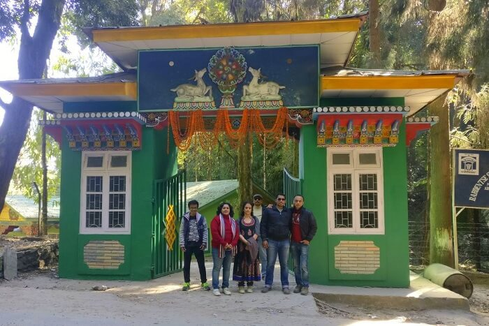 Shantanu northeast trip- posing outside monastery in namchi