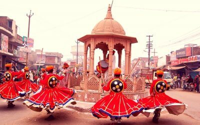 Rajasthani men dancing on the eve of Holi