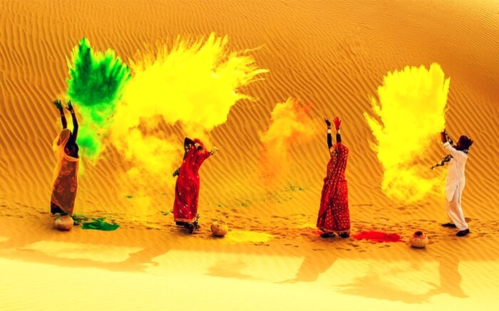 Rajasthani men and women celebrating Holi in desert