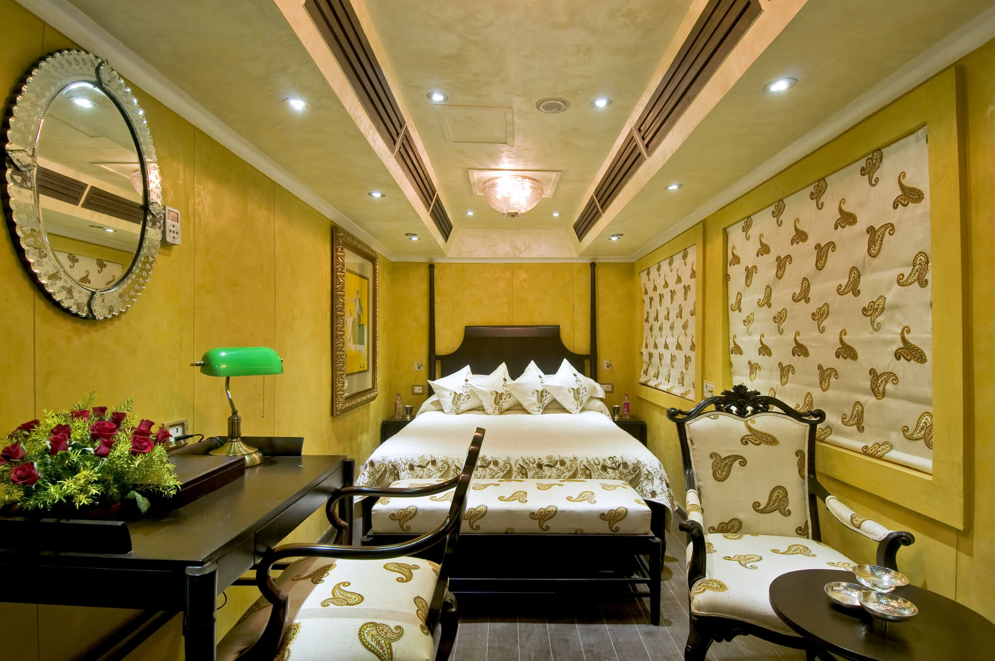 a luxurious coach with a bed and sofa on a luxurious train