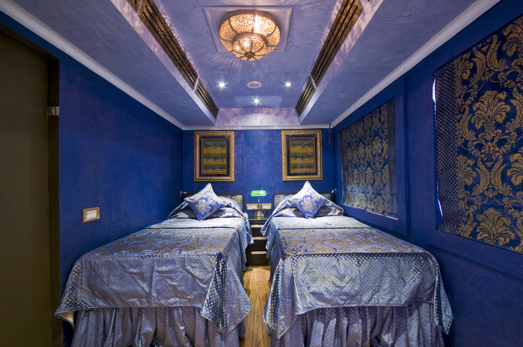 a blue coach with luxurious bed in a luxurious train