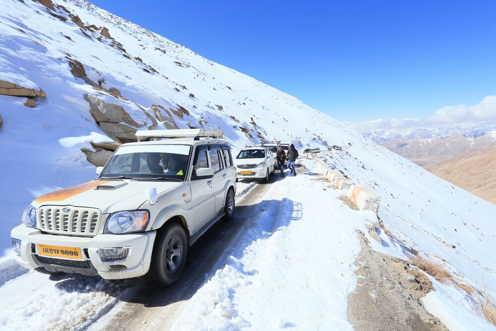 cars on snow covered changla pass