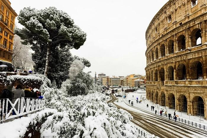 snowfall rome colosseum