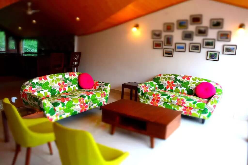 colourful sofas in the living room of a cottage