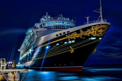 a disney cruise line at night