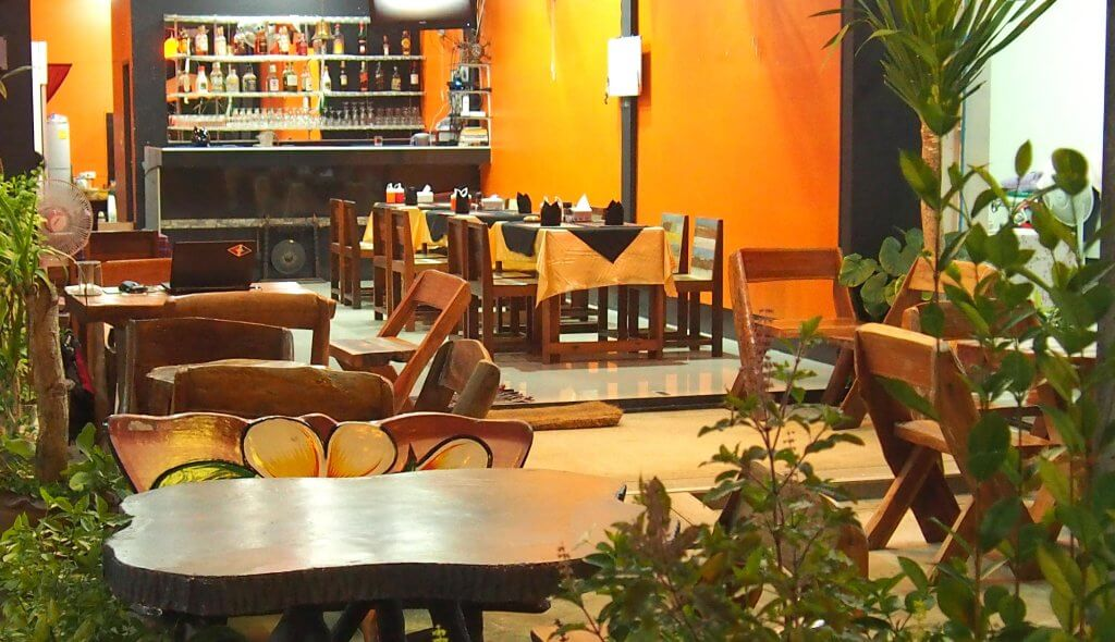 wooden furniture and beautiful decor of an Indian restaurant