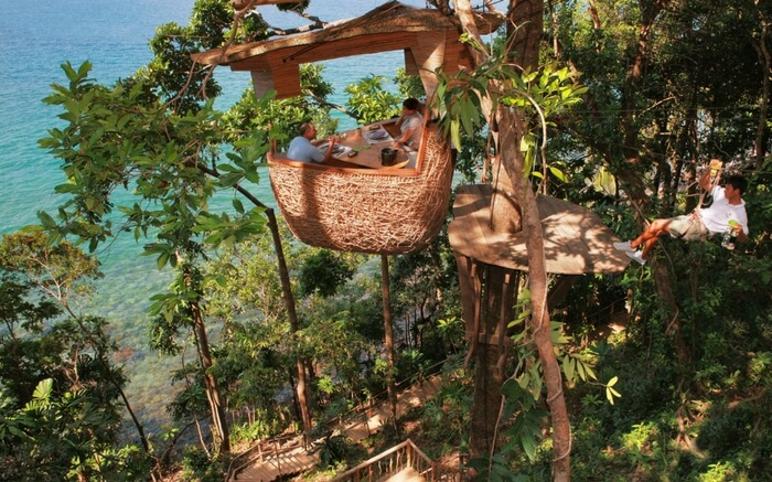 A view of people dining at Soneva Kiri Resort in Thailand