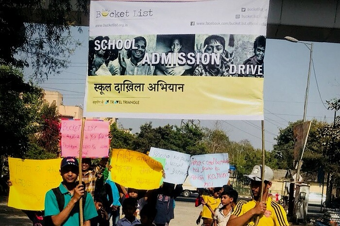Organisers and students rallying during the school admission drive