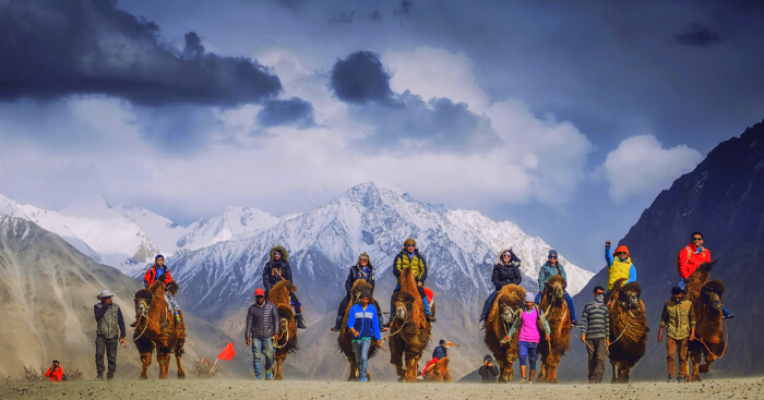 tourist enjoying horse riding in april in Ladakh