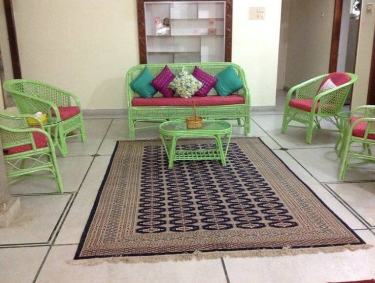a homestay with green bamboo wood furniture