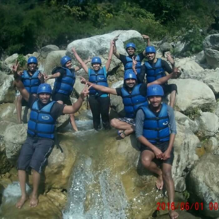 friends enjoying river rafting