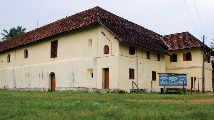 Mattancherry Palace amid lush green field