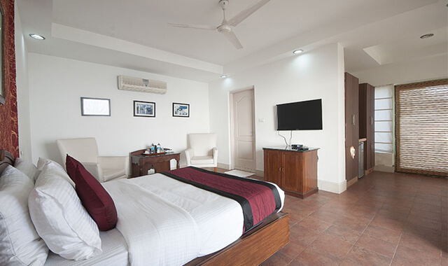 a resort room with a comfortable bed