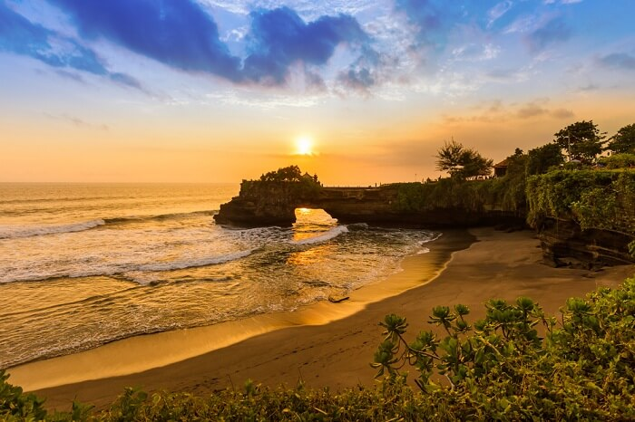 Watch sunset at Tanah Lot