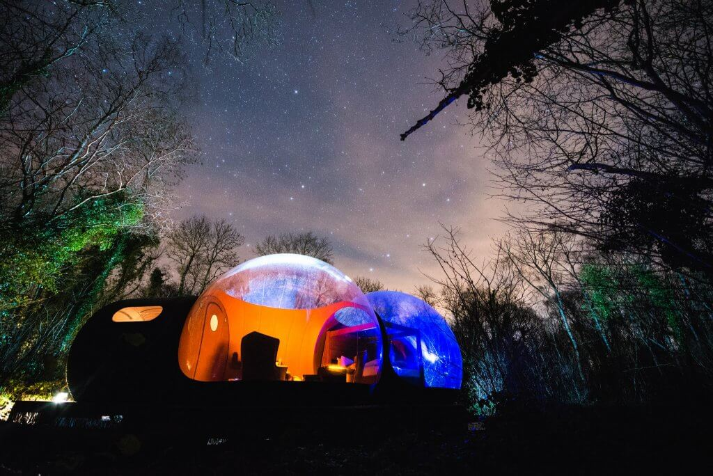 A view of bubble hotel in Ireland at night