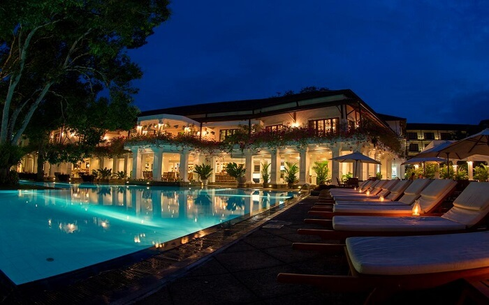 an outdoor swimming pool of a luxurious hotel