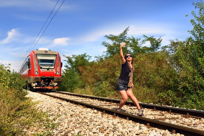 girl train track selfie