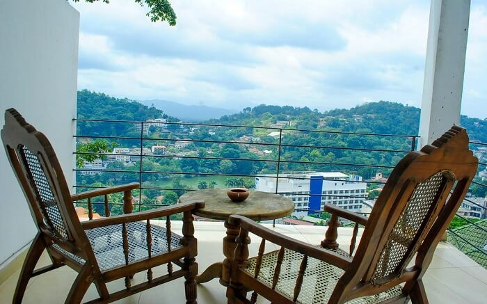 two wooden chairs in balcony with mountain views