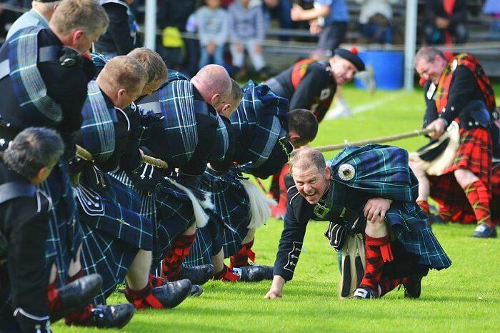 Attend a Highland Game scotland