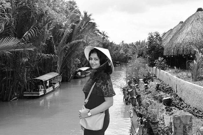 pallavi vietnam family trip: posing near mekong river