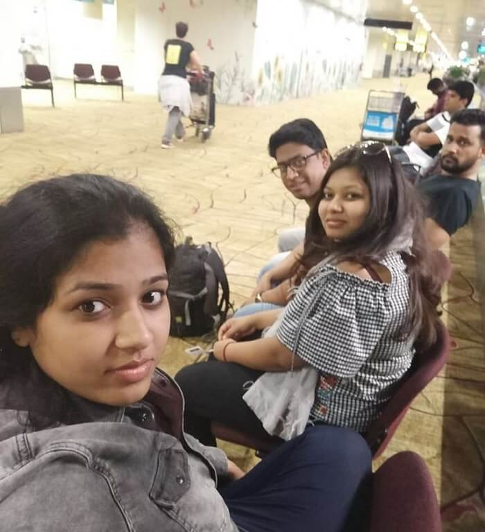 pallavi vietnam family trip: dining at airport groupfie