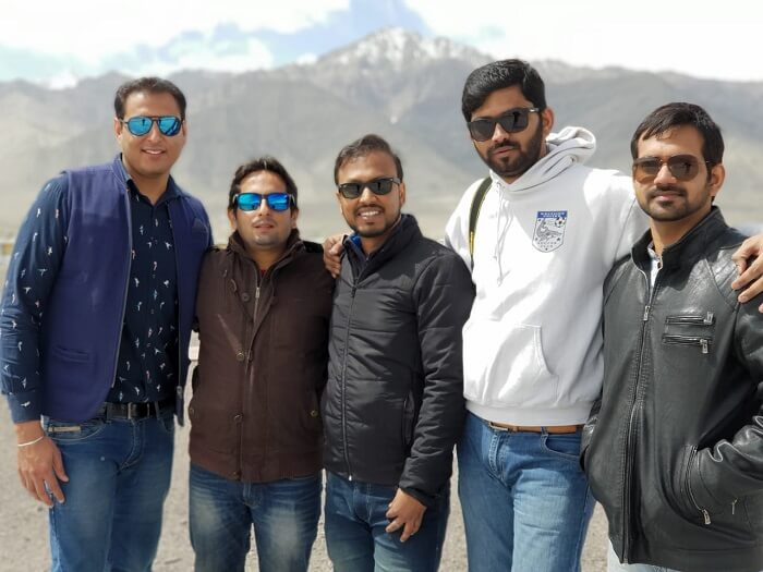 friends posing for a picture in ladakh