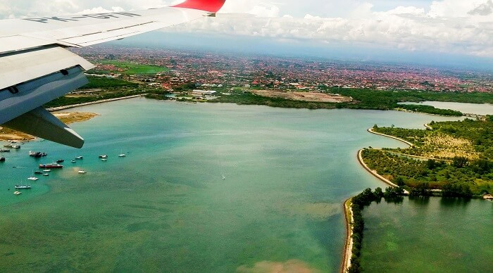 couple clicking bali's photo from plane