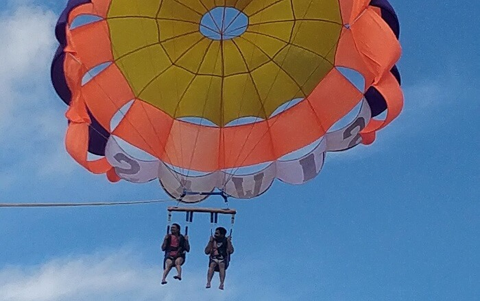couple doing parasailing