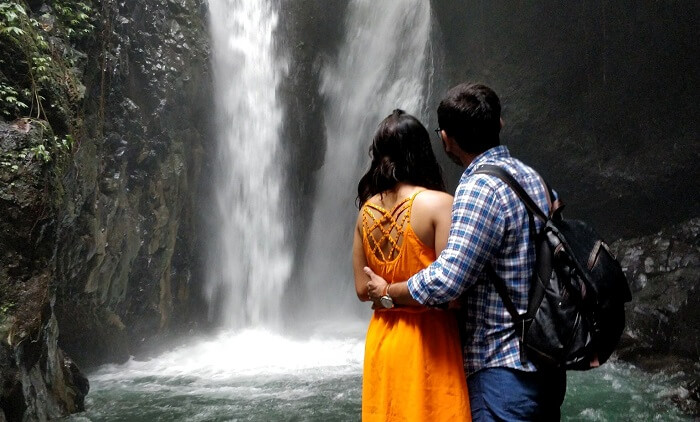 couple witnessing the gitgit waterfall