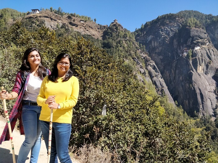 shakti and her friend on the tigers nest trek
