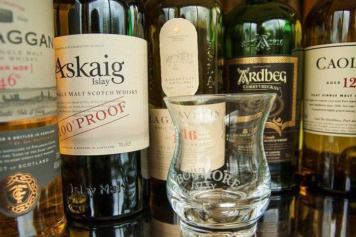 Chug whiskey at a distillery
