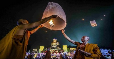 Monks with candle on Vesak day