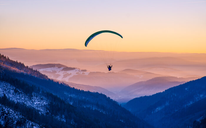 A paraglider in mountains