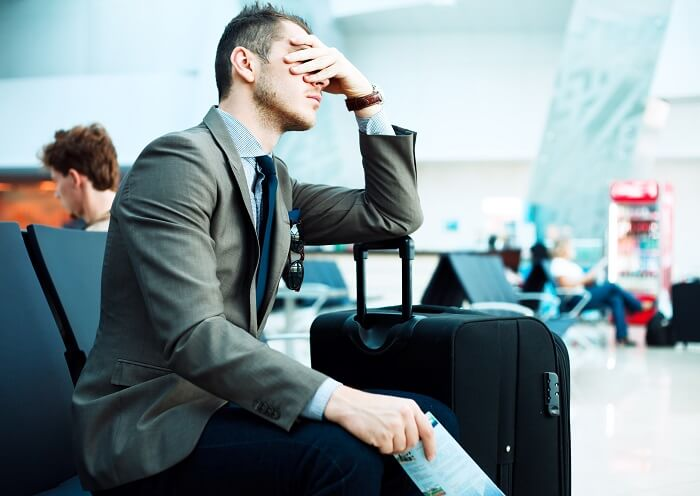 flight delayed stressed man