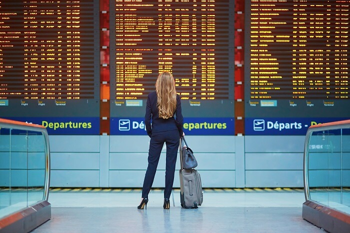 a woman checking flight status at airport
