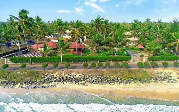 Ashokam Beach Resort with a grand lawn and beach views ss