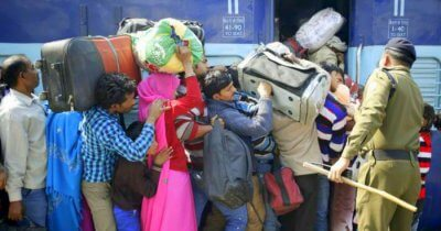 people carrying luggage in Indian train