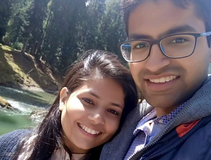 couple taking selfie near river