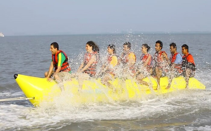 People enjoying a ride on banana boat
