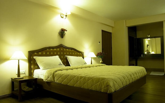 The comfortable bed of Hotel Blue Bird
